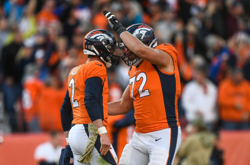 DENVER, CO - NOVEMBER 3: Brandon Allen #2 of the Denver Broncos is congratulated by Garett Bolles #72 after a second-quarter touchdown pass against the Cleveland Browns at Empower Field at Mile High on November 3, 2019 in Denver, Colorado. (Photo by Dustin Bradford/Getty Images)