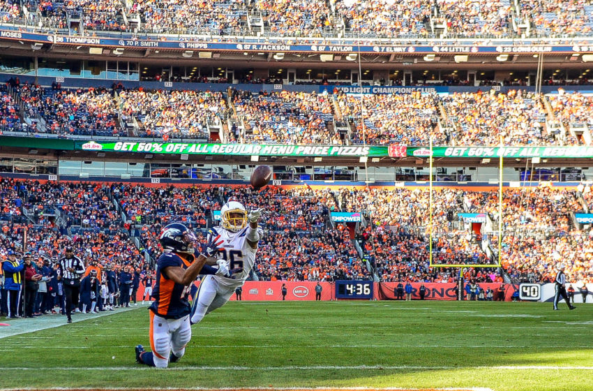 DENVER, CO - DECEMBER 1: Courtland Sutton #14 of the Denver Broncos catches a first quarter touchdown reception under coverage by Casey Hayward Jr. #26 of the Los Angeles Chargers during a game at Empower Field at Mile High on December 1, 2019 in Denver, Colorado. (Photo by Dustin Bradford/Getty Images)