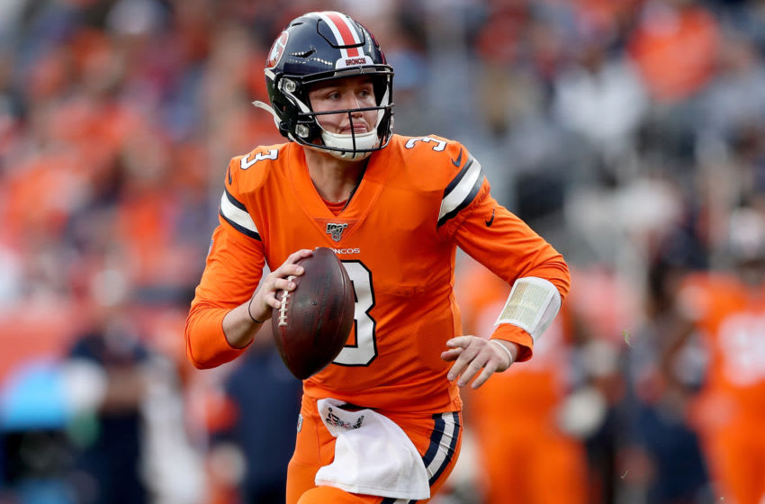 DENVER, COLORADO - DECEMBER 22: Drew Lock #3 of the Denver Broncos runs out of the pocket against the Detroit Lions in the second quarter at Empower Field at Mile High on December 22, 2019 in Denver, Colorado. (Photo by Matthew Stockman/Getty Images)