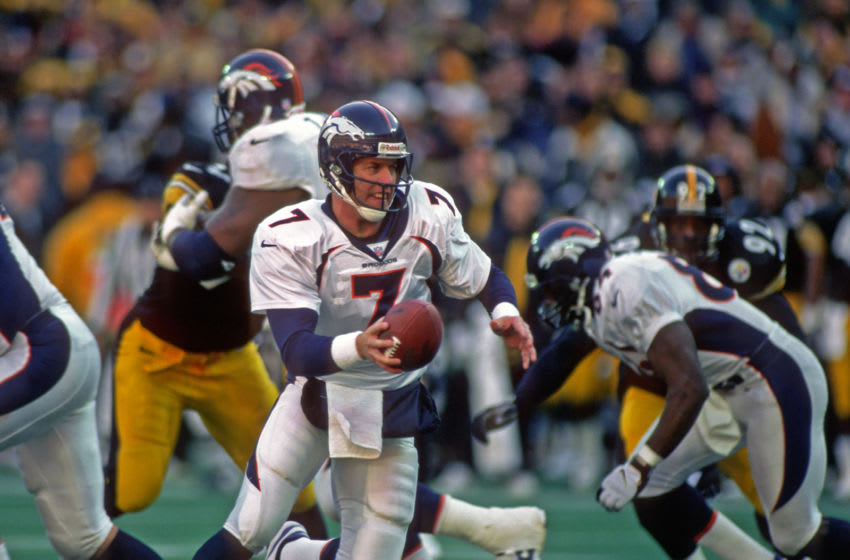 PITTSBURGH, PA - JANUARY 11: Quarterback John Elway #7 of the Denver Broncos looks to hand off the football during the 1997 season AFC Championship game against the Pittsburgh Steelers at Three Rivers Stadium on January 11, 1998 in Pittsburgh, Pennsylvania. The Broncos defeated the Steelers 24-21. (Photo by George Gojkovich/Getty Images)