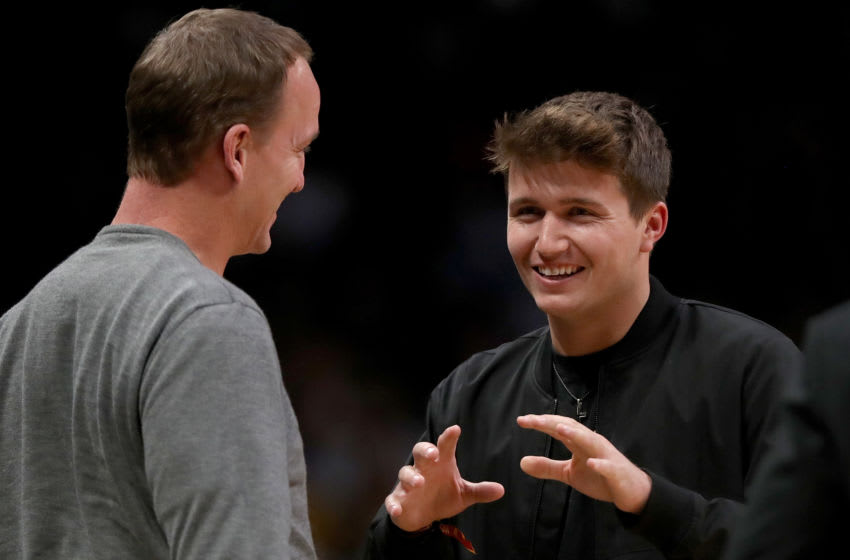 DENVER, COLORADO - MARCH 01: Former and current Denver Broncos quarterbacks Peyton Manning and Drew Lock chat during a time out between the Toronto Raptors and the Denver Nuggets in the fourth quarter at the Pepsi Center on March 01, 2020 in Denver, Colorado. NOTE TO USER: User expressly acknowledges and agrees that, by downloading and or using this photograph, User is consenting to the terms and conditions of the Getty Images License Agreement. ( (Photo by Matthew Stockman/Getty Images)