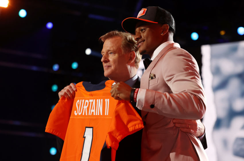 CLEVELAND, OHIO - APRIL 29: Patrick Surtain II poses with NFL Commissioner Roger Goodell onstage after being selected ninth by the Denver Broncos during round one of the 2021 NFL Draft at the Great Lakes Science Center on April 29, 2021 in Cleveland, Ohio. (Photo by Gregory Shamus/Getty Images)