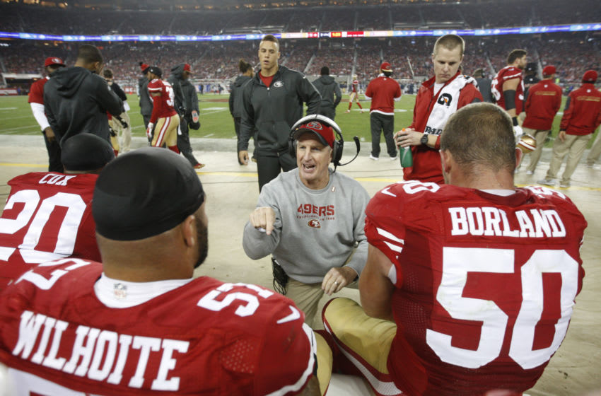 SANTA CLARA, CA - NOVEMBER 27: Linebackers Coach Jim Leavitt of the San Francisco 49ers talks with Michael Wilhoite #57 and Chris Borland #50 during the game against the Seattle Seahawks at Levi Stadium on November 27, 2014 in Santa Clara, California. The Seahawks defeated the 49ers 19-3. (Photo by Michael Zagaris/San Francisco 49ers/Getty Images)