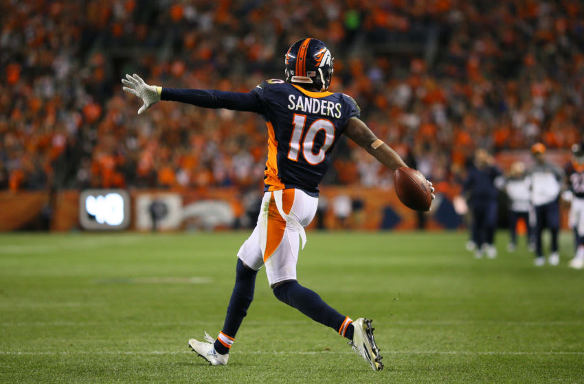 DENVER, CO - OCTOBER 24: Wide receiver Emmanuel Sanders #10 of the Denver Broncos celebrates a long catch and is tackled at the two-yard-line in the third quarter of the game against the Houston Texans at Sports Authority Field at Mile High on October 24, 2016 in Denver, Colorado. (Photo by Justin Edmonds/Getty Images)