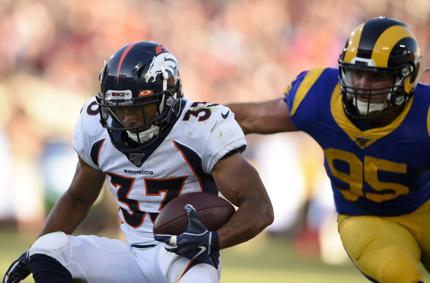 Aug 24, 2019; Los Angeles, CA, USA; Denver Broncos running back Khalfani Muhammad (33) runs after a catch while Los Angeles Rams linebacker Troy Reeder (95) defends during the first half at Los Angeles Memorial Coliseum. Mandatory Credit: Kelvin Kuo-USA TODAY Sports