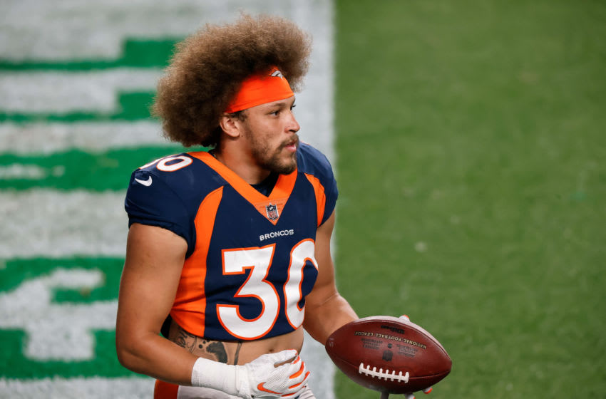 Sep 14, 2020; Denver, Colorado, USA; Denver Broncos running back Phillip Lindsay (30) warms up before the game against the Tennessee Titans at Empower Field at Mile High. Mandatory Credit: Isaiah J. Downing-USA TODAY Sports