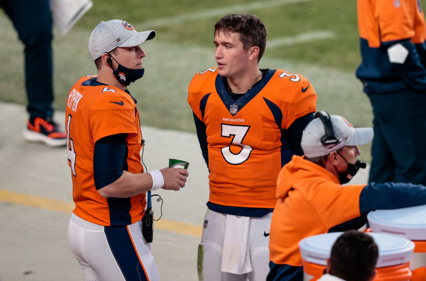 Nov 1, 2020; Denver, Colorado, USA; Denver Broncos quarterback Drew Lock (3) talks with quarterback Brett Rypien (4) in the fourth quarter against the Los Angeles Chargers at Empower Field at Mile High. Mandatory Credit: Isaiah J. Downing-USA TODAY Sports