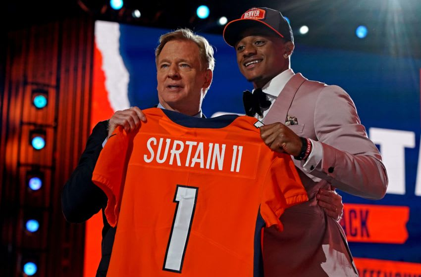 Apr 29, 2021; Cleveland, Ohio, USA; Pat Sutrain Jr. (Alabama) with NFL commissioner Roger Goodell after being selected by Denver Broncos as the number nine overall pick in the first round of the 2021 NFL Draft at First Energy Stadium. Mandatory Credit: Kirby Lee-USA TODAY Sports