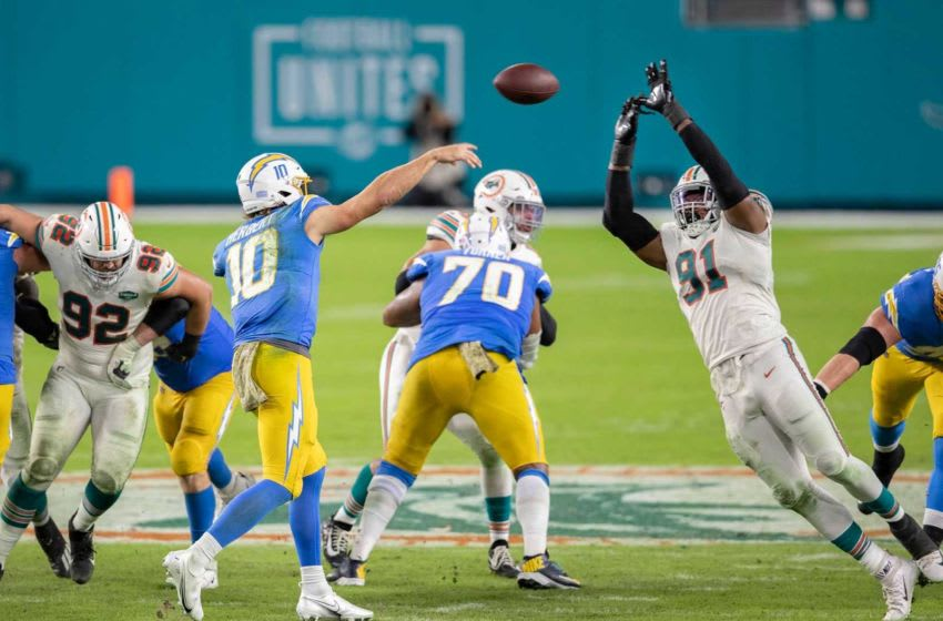 Miami Dolphins defensive end Emmanuel Ogbah (91) tips a pass attempted by Los Angeles Chargers quarterback Justin Herbert (10) on fourth down and one at Hard Rock Stadium in Miami Gardens, November 15, 2020. Dolphins took over on downs. (ALLEN EYESTONE / THE PALM BEACH POST) 20201115 Dolphins Chargers