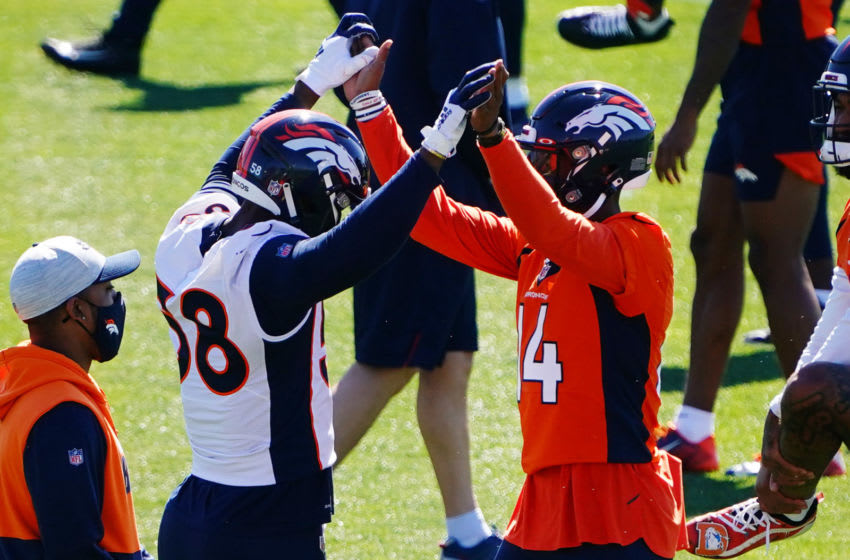 May 24, 2021; Englewood, Colorado, USA; Denver Broncos wide receiver Courtland Sutton (14) greets Denver Broncos outside linebacker Von Miller (58) during organized team activities at the UCHealth Training Center. Mandatory Credit: Ron Chenoy-USA TODAY Sports
