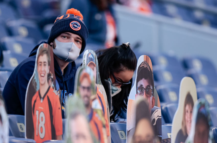 Nov 1, 2020; Denver, Colorado, USA; Denver Broncos fans sit with cutouts as they watch in the second quarter against the Los Angeles Chargers at Empower Field at Mile High. Mandatory Credit: Isaiah J. Downing-USA TODAY Sports