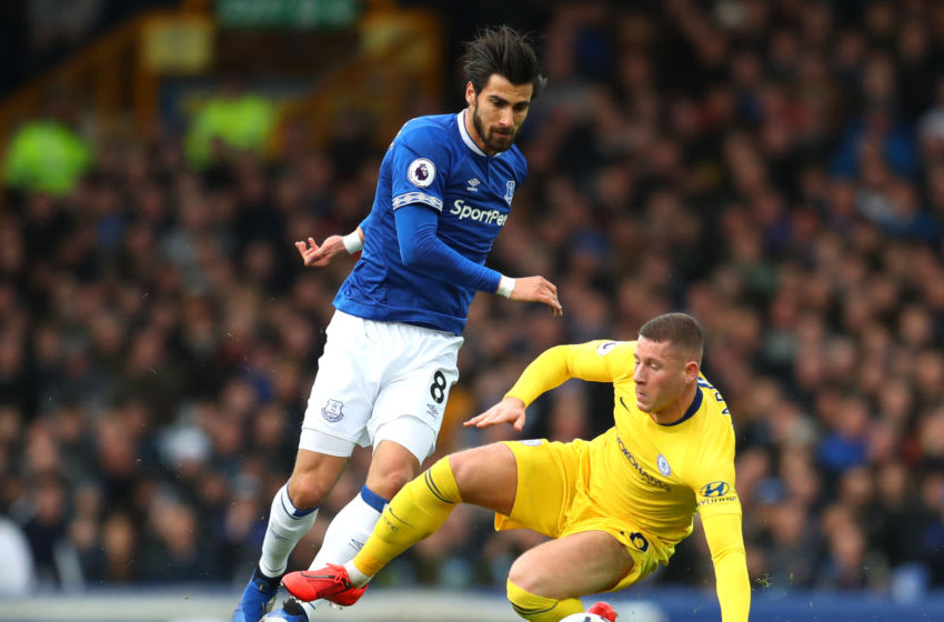 LIVERPOOL, ENGLAND - MARCH 17: Ross Barkley of Chelsea is tackled by Andre Gomes of Everton during the Premier League match between Everton FC and Chelsea FC at Goodison Park on March 17, 2019 in Liverpool, United Kingdom. (Photo by Catherine Ivill/Getty Images)