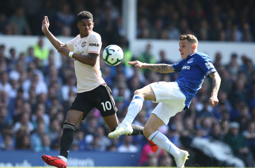 LIVERPOOL, ENGLAND - APRIL 21: Lucas Digne of Everton clears from Marcus Rashford of Manchester United during the Premier League match between Everton FC and Manchester United at Goodison Park on April 21, 2019 in Liverpool, United Kingdom. (Photo by Jan Kruger/Getty Images)