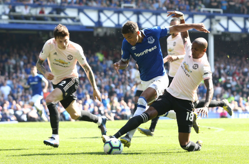 LIVERPOOL, ENGLAND - APRIL 21: Dominic Calvert-Lewin of Everton is challenged by Ashley Young of Manchester United during the Premier League match between Everton FC and Manchester United at Goodison Park on April 21, 2019 in Liverpool, United Kingdom. (Photo by Jan Kruger/Getty Images)