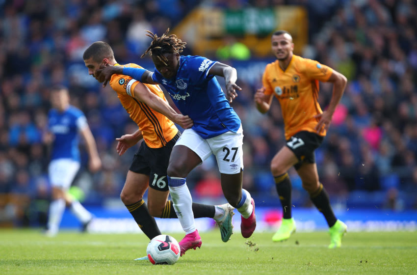 LIVERPOOL, ENGLAND - SEPTEMBER 01: Conor Coady of Wolverhampton Wanderers and Moise Kean of Everton during the Premier League match between Everton FC and Wolverhampton Wanderers at Goodison Park on September 1, 2019 in Liverpool, United Kingdom. (Photo by Robbie Jay Barratt - AMA/Getty Images)