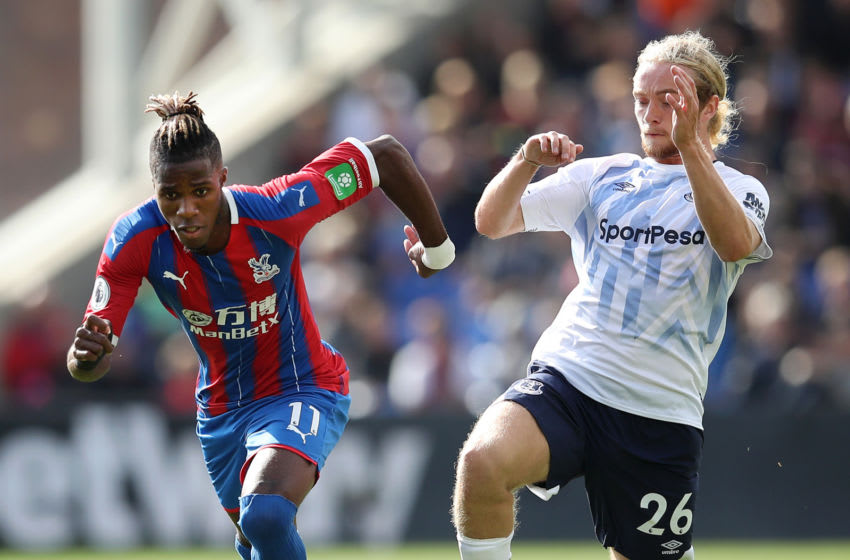 LONDON, ENGLAND - AUGUST 10: Wilfried Zaha of Crystal Palace is challenged by Tom Davies of Everton during the Premier League match between Crystal Palace and Everton FC at Selhurst Park on August 10, 2019 in London, United Kingdom. (Photo by Christopher Lee/Getty Images)