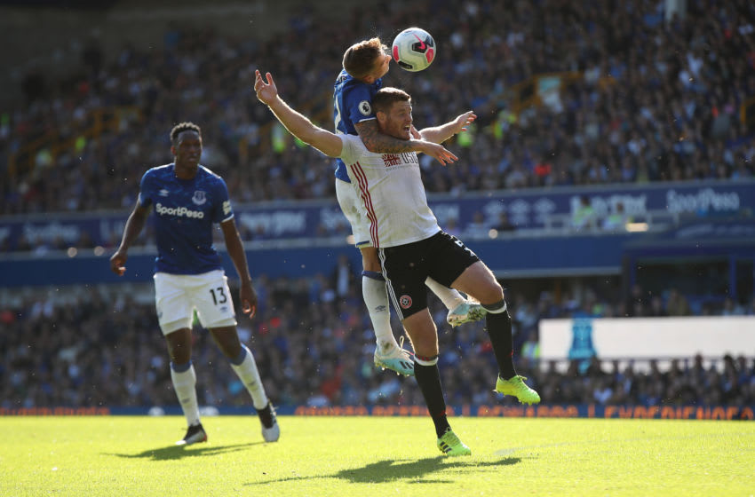 LIVERPOOL, ENGLAND - SEPTEMBER 21: Lucas Digne of Everton outjumps Jack O'Connell of Sheffield United during the Premier League match between Everton FC and Sheffield United at Goodison Park on September 21, 2019 in Liverpool, United Kingdom. (Photo by Christopher Lee/Getty Images)