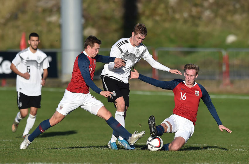 PORTADOWN, NORTHERN IRELAND - NOVEMBER 15: Julian Albrecht of Germany and Sivert Mannsverk of Norway during the Germany v Norway u19 international friendly match on November 15, 2019 in Portadown, Northern Ireland. (Photo by Charles McQuillan/Getty Images for DFB)
