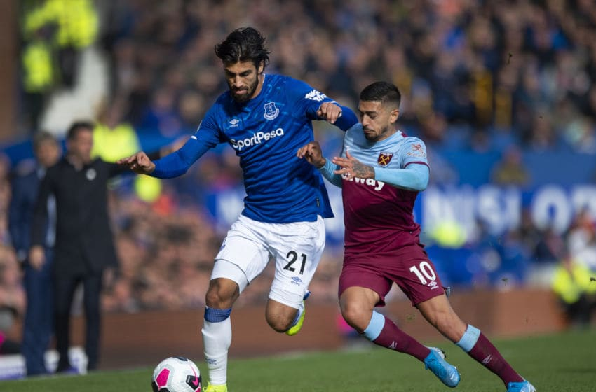 LIVERPOOL, ENGLAND - OCTOBER 19: Andre Gomes of Everton and Manuel Lanzini of West Ham United in action during the Premier League match between Everton FC and West Ham United at Goodison Park on October 19, 2019 in Liverpool, United Kingdom. (Photo by Visionhaus)
