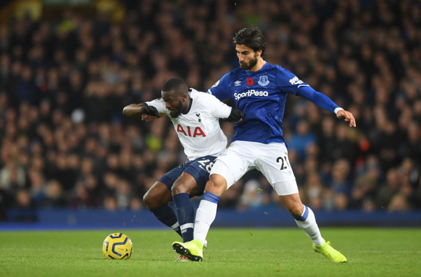 LIVERPOOL, ENGLAND - NOVEMBER 03: Tanguy NDombele of Tottenham Hotspur looks to break past Andre Gomes of Everton during the Premier League match between Everton FC and Tottenham Hotspur at Goodison Park on November 03, 2019 in Liverpool, United Kingdom. (Photo by Michael Regan/Getty Images)