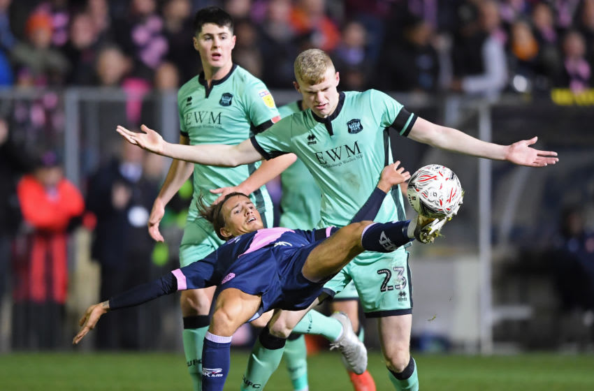 LONDON, ENGLAND - NOVEMBER 08: Ben Chapman of Dulwich Hamlet is challenged by Jarrad Branthwaite of Carlisle United during the FA Cup First Round match between Dulwich Hamlet and Carlisle United at Champion Hill on November 08, 2019 in London, England. (Photo by Alex Davidson/Getty Images)