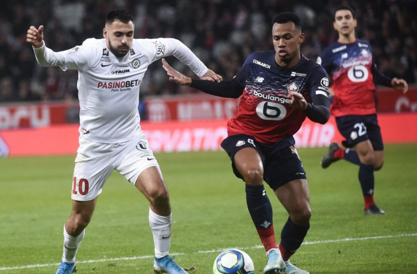 Lille's Brazilian defender Gabriel dos Santos Magalhaes (R) fights for the ball with Montpellier's French forward Gaetan Laborde during the French L1 football match between Lille OSC (LOSC) and Montpellier Herault Sport Club (MHSC) at the Pierre Mauroy Stadium in Villeneuve-d'Ascq, on December 13, 2019. (Photo by FRANCOIS LO PRESTI / AFP) (Photo by FRANCOIS LO PRESTI/AFP via Getty Images)