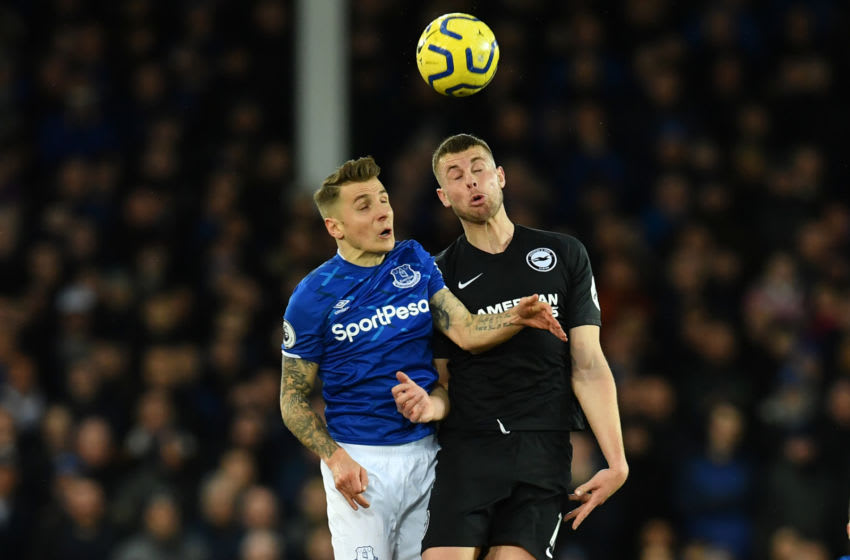Everton's French defender Lucas Digne (L) vies with Brighton's English defender Adam Webster (R) during the English Premier League football match between Everton and Brighton Hove and Albion at Goodison Park in Liverpool, north west England on January 11, 2020. (Photo by Paul ELLIS / AFP) / RESTRICTED TO EDITORIAL USE. No use with unauthorized audio, video, data, fixture lists, club/league logos or 'live' services. Online in-match use limited to 120 images. An additional 40 images may be used in extra time. No video emulation. Social media in-match use limited to 120 images. An additional 40 images may be used in extra time. No use in betting publications, games or single club/league/player publications. / (Photo by PAUL ELLIS/AFP via Getty Images)