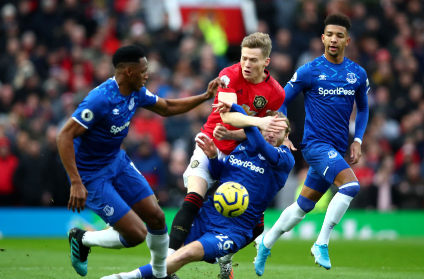 MANCHESTER, ENGLAND - DECEMBER 15: Scott McTominay of Manchester United is challenged by Tom Davies of Everton during the Premier League match between Manchester United and Everton FC at Old Trafford on December 15, 2019 in Manchester, United Kingdom. (Photo by Clive Brunskill/Getty Images)