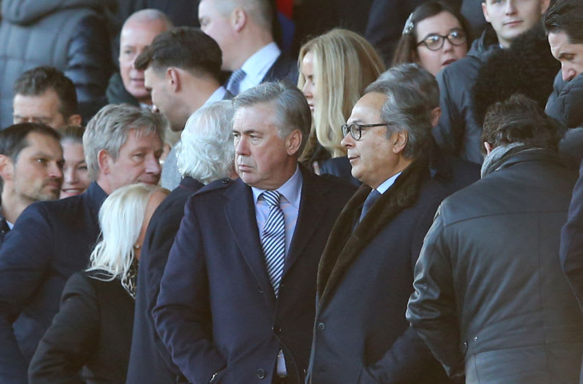 LIVERPOOL, ENGLAND - DECEMBER 21: Carlo Ancelotti, Manager of Everton talks to Everton owner Farhad Moshiri in the stands during the Premier League match between Everton FC and Arsenal FC at Goodison Park on December 21, 2019 in Liverpool, United Kingdom. (Photo by Alex Livesey/Getty Images)