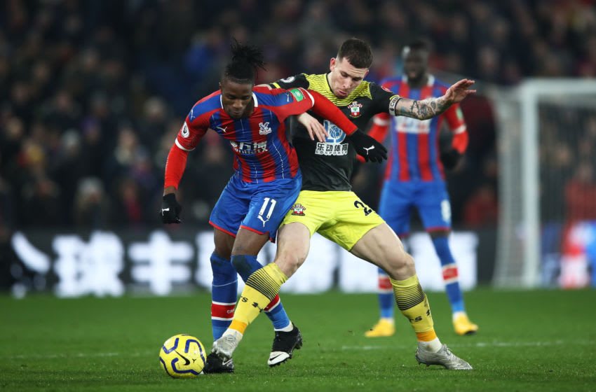 LONDON, ENGLAND - JANUARY 21: Wilfried Zaha of Crystal Palace is tackled by Pierre-Emile Hojbjerg of Southampton during the Premier League match between Crystal Palace and Southampton FC at Selhurst Park on January 21, 2020 in London, United Kingdom. (Photo by Bryn Lennon/Getty Images)
