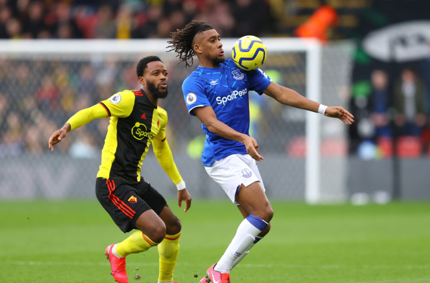 WATFORD, ENGLAND - FEBRUARY 01: Alex Iwobi of Everton is challenged by Nathaniel Chalobah of Watford during the Premier League match between Watford FC and Everton FC at Vicarage Road on February 01, 2020 in Watford, United Kingdom. (Photo by Richard Heathcote/Getty Images)