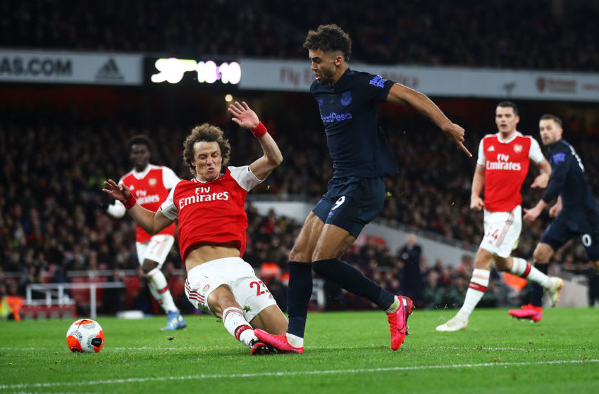 LONDON, ENGLAND - FEBRUARY 23: Dominic Calvert-Lewin of Everton shoots at goal as David Luiz of Arsenal fails to block during the Premier League match between Arsenal FC and Everton FC at Emirates Stadium on February 23, 2020 in London, United Kingdom. (Photo by Julian Finney/Getty Images)