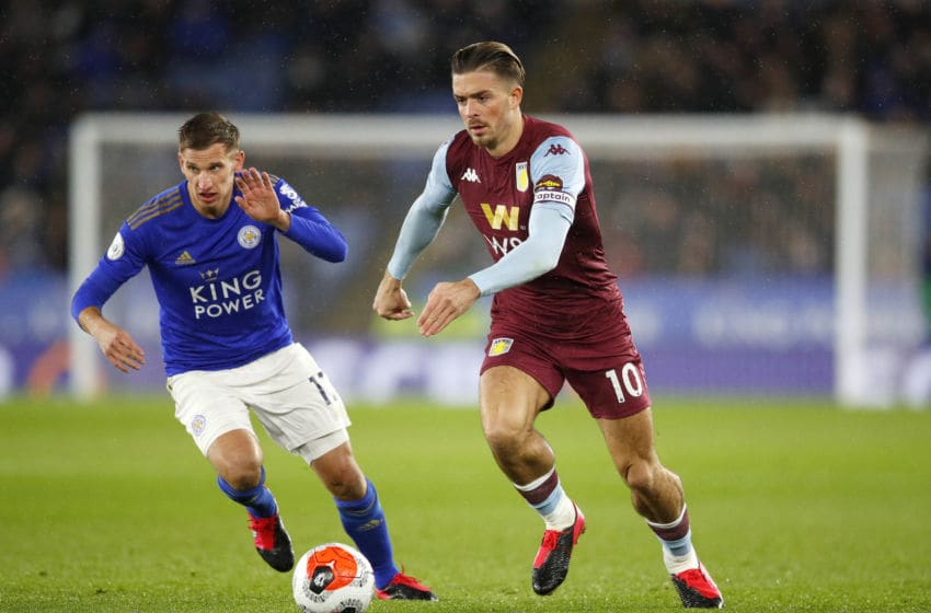 LEICESTER, ENGLAND - MARCH 09: Marc Albrighton of Leicester City (l) challenges Jack Grealish of Aston Villa during the Premier League match between Leicester City and Aston Villa at The King Power Stadium on March 09, 2020 in Leicester, United Kingdom. (Photo by Malcolm Couzens/Getty Images)