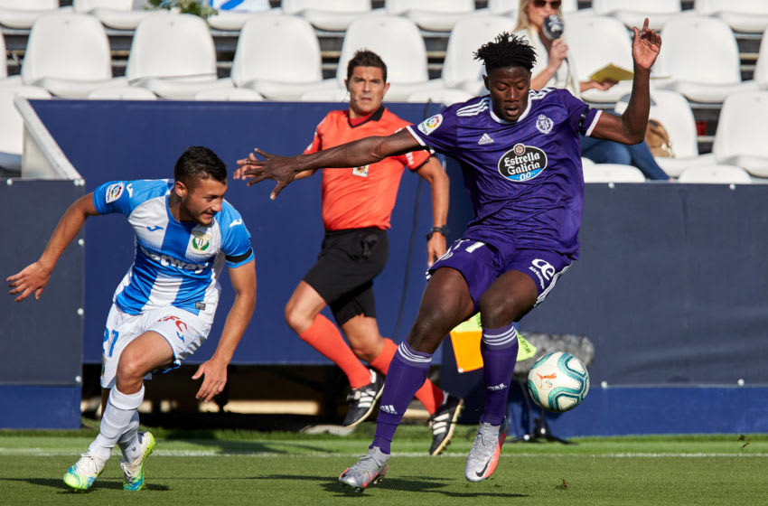 LEGANES, SPAIN - JUNE 13: (BILD ZEITUNG OUT) Mohammed Salisu of Real Valladolid and Oscar Garcia of CD Leganes battle for the ball during the Liga match between CD Leganes and Real Valladolid CF at Estadio Municipal de Butarque June 13, 2020 in Leganes, Spain. (Photo by Berengui/DeFodi Images via Getty Images)