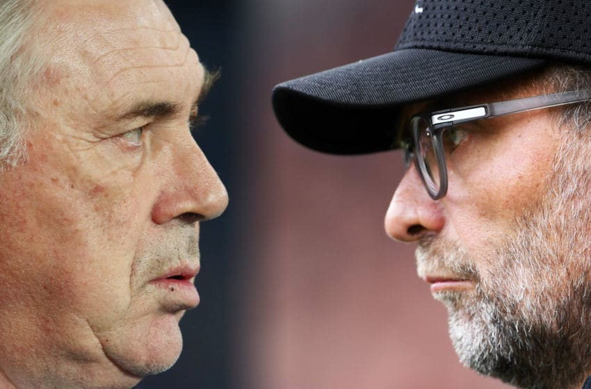 FILE PHOTO (EDITORS NOTE: COMPOSITE OF IMAGES - Image numbers 1197011810, 1177630705- GRADIENT ADDED) In this composite image a comparison has been made between Carlo Ancelotti, Manager of Everton (L) and Jurgen Klopp, Manager of Liverpool. Everton and Liverpool meet in the Merseyside derby on June 21,2020 at Goodison Park in Liverpool, England. ***LEFT IMAGE*** MANCHESTER, ENGLAND - JANUARY 01: Carlo Ancelotti, Manager of Everton looks on during the Premier League match between Manchester City and Everton FC at Etihad Stadium on January 01, 2020 in Manchester, United Kingdom. (Photo by Clive Brunskill/Getty Images) ***RIGHT IMAGE*** SHEFFIELD, ENGLAND - SEPTEMBER 28: Jurgen Klopp, Manager of Liverpool looks on during the Premier League match between Sheffield United and Liverpool FC at Bramall Lane on September 28, 2019 in Sheffield, United Kingdom. (Photo by Laurence Griffiths/Getty Images)