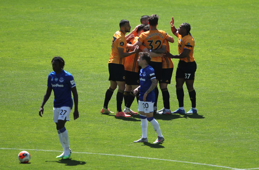 Wolverhampton Wanderers' Portuguese midfielder Diogo Jota celebrates with teammates after scoring their third goal during the English Premier League football match between Wolverhampton Wanderers and Everton at the Molineux stadium in Wolverhampton, central England on July 12, 2020. (Photo by MOLLY DARLINGTON / POOL / AFP) / RESTRICTED TO EDITORIAL USE. No use with unauthorized audio, video, data, fixture lists, club/league logos or 'live' services. Online in-match use limited to 120 images. An additional 40 images may be used in extra time. No video emulation. Social media in-match use limited to 120 images. An additional 40 images may be used in extra time. No use in betting publications, games or single club/league/player publications. / (Photo by MOLLY DARLINGTON/POOL/AFP via Getty Images)