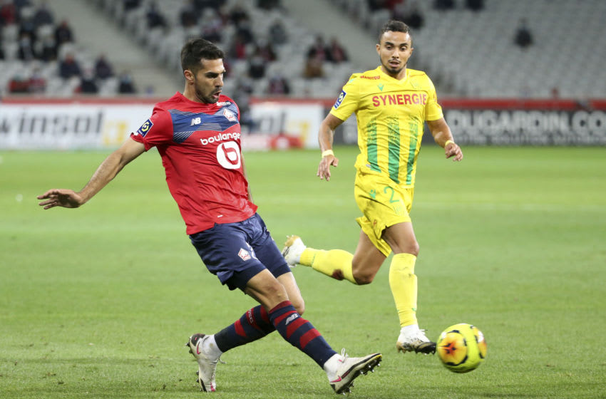 LILLE, FRANCE - SEPTEMBER 25: Mehmet Zeki Celik of Lille, Fabio Da Silva of FC Nantes during the Ligue 1 match between Lille OSC (LOSC) and FC Nantes at Stade Pierre Mauroy on September 25, 2020 in Villeneuve d'Ascq near Lille, France. (Photo by Jean Catuffe/Getty Images)