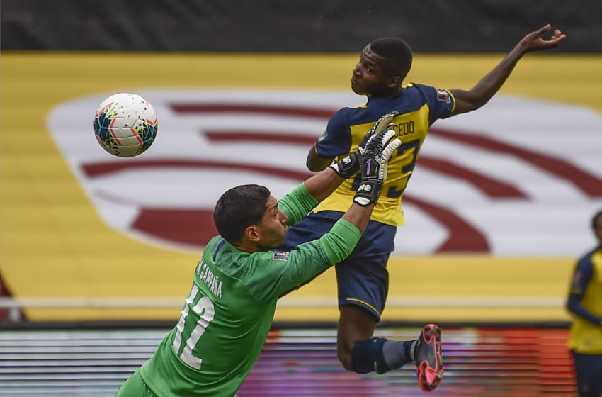 Ecuador's Moises Caicedo (R) scores against Uruguay's goalkeeper Martin Campana during their 2022 FIFA World Cup South American qualifier football match at the Rodrigo Paz Delgado Stadium in Quito on October 13, 2020, amid the COVID-19 novel coronavirus pandemic. (Photo by Rodrigo BUENDIA / AFP) (Photo by RODRIGO BUENDIA/AFP via Getty Images)