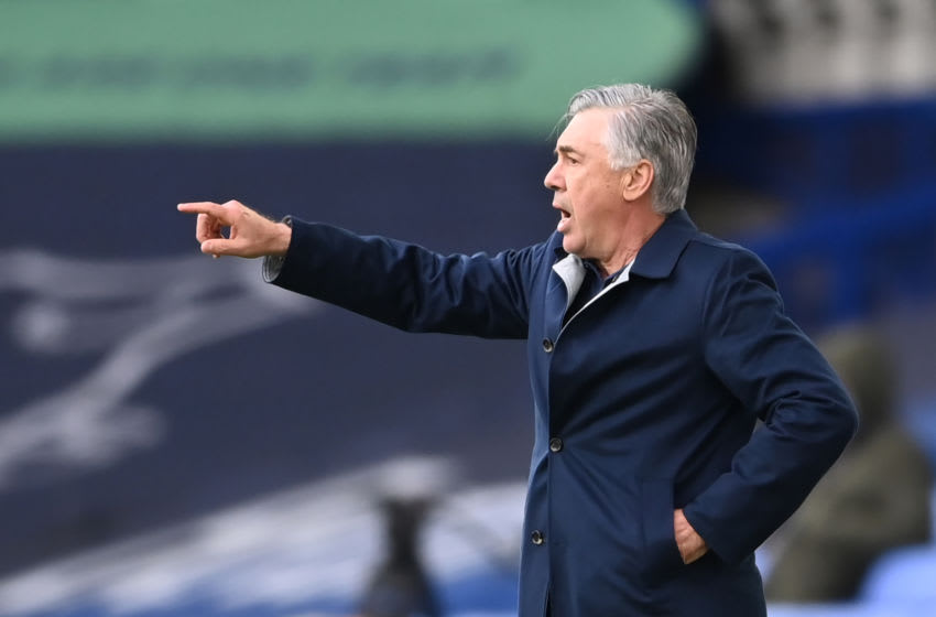 Everton's Italian head coach Carlo Ancelotti gestures during the English Premier League football match between Everton and Liverpool at Goodison Park in Liverpool, north west England on October 17, 2020. (Photo by Laurence Griffiths / POOL / AFP) / RESTRICTED TO EDITORIAL USE. No use with unauthorized audio, video, data, fixture lists, club/league logos or 'live' services. Online in-match use limited to 120 images. An additional 40 images may be used in extra time. No video emulation. Social media in-match use limited to 120 images. An additional 40 images may be used in extra time. No use in betting publications, games or single club/league/player publications. / (Photo by LAURENCE GRIFFITHS/POOL/AFP via Getty Images)