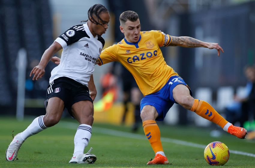 Fulham's Jamaican striker Bobby Decordova-Reid (L) vies with Everton's French defender Lucas Digne during the English Premier League football match between Fulham and Everton at Craven Cottage in London on November 22, 2020. (Photo by JOHN SIBLEY / POOL / AFP) / RESTRICTED TO EDITORIAL USE. No use with unauthorized audio, video, data, fixture lists, club/league logos or 'live' services. Online in-match use limited to 120 images. An additional 40 images may be used in extra time. No video emulation. Social media in-match use limited to 120 images. An additional 40 images may be used in extra time. No use in betting publications, games or single club/league/player publications. / (Photo by JOHN SIBLEY/POOL/AFP via Getty Images)