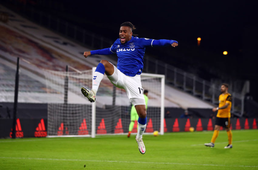 WOLVERHAMPTON, ENGLAND - JANUARY 12: Alex Iwobi of Everton celebrates scoring the opening goal during the Premier League match between Wolverhampton Wanderers and Everton at Molineux on January 12, 2021 in Wolverhampton, United Kingdom. Sporting stadiums around England remain under strict restrictions due to the Coronavirus Pandemic as Government social distancing laws prohibit fans inside venues resulting in games being played behind closed doors. (Photo by Marc Atkins/Getty Images)