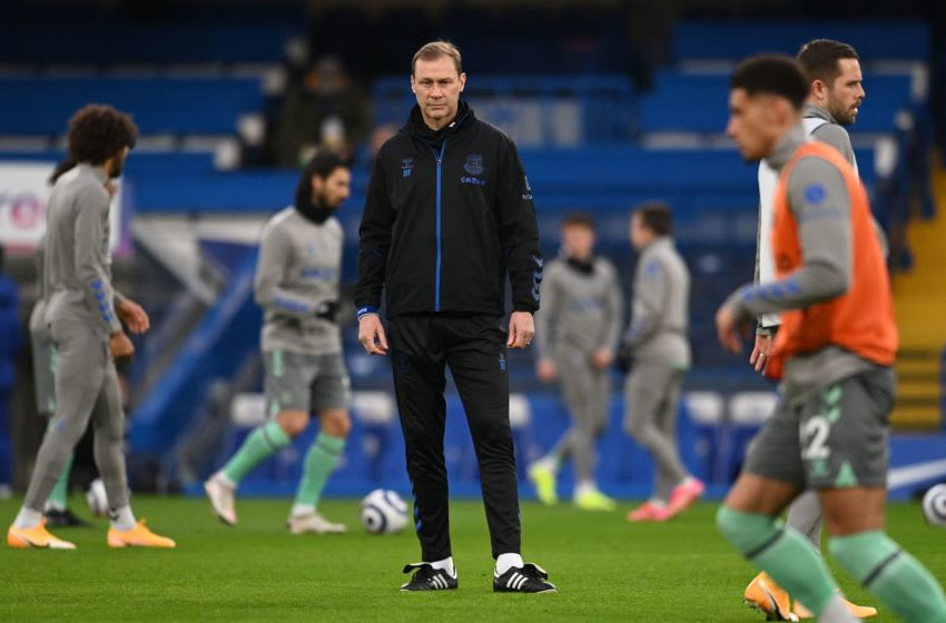 Everton's assistant manager Duncan Ferguson (C) takes the warm up session ahead of the English Premier League football match between Chelsea and Everton at Stamford Bridge in London on March 8, 2021. - RESTRICTED TO EDITORIAL USE. No use with unauthorized audio, video, data, fixture lists, club/league logos or 'live' services. Online in-match use limited to 120 images. An additional 40 images may be used in extra time. No video emulation. Social media in-match use limited to 120 images. An additional 40 images may be used in extra time. No use in betting publications, games or single club/league/player publications. (Photo by Glyn KIRK / POOL / AFP) / RESTRICTED TO EDITORIAL USE. No use with unauthorized audio, video, data, fixture lists, club/league logos or 'live' services. Online in-match use limited to 120 images. An additional 40 images may be used in extra time. No video emulation. Social media in-match use limited to 120 images. An additional 40 images may be used in extra time. No use in betting publications, games or single club/league/player publications. / RESTRICTED TO EDITORIAL USE. No use with unauthorized audio, video, data, fixture lists, club/league logos or 'live' services. Online in-match use limited to 120 images. An additional 40 images may be used in extra time. No video emulation. Social media in-match use limited to 120 images. An additional 40 images may be used in extra time. No use in betting publications, games or single club/league/player publications. (Photo by GLYN KIRK/POOL/AFP via Getty Images)