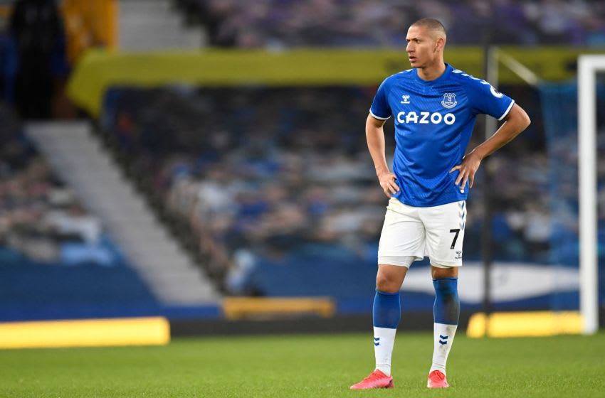Everton's Brazilian striker Richarlison reacts during the English Premier League football match between Everton and Crystal Palace at Goodison Park in Liverpool, north west England on April 5, 2021. - RESTRICTED TO EDITORIAL USE. No use with unauthorized audio, video, data, fixture lists, club/league logos or 'live' services. Online in-match use limited to 120 images. An additional 40 images may be used in extra time. No video emulation. Social media in-match use limited to 120 images. An additional 40 images may be used in extra time. No use in betting publications, games or single club/league/player publications. (Photo by PETER POWELL / POOL / AFP) / RESTRICTED TO EDITORIAL USE. No use with unauthorized audio, video, data, fixture lists, club/league logos or 'live' services. Online in-match use limited to 120 images. An additional 40 images may be used in extra time. No video emulation. Social media in-match use limited to 120 images. An additional 40 images may be used in extra time. No use in betting publications, games or single club/league/player publications. / RESTRICTED TO EDITORIAL USE. No use with unauthorized audio, video, data, fixture lists, club/league logos or 'live' services. Online in-match use limited to 120 images. An additional 40 images may be used in extra time. No video emulation. Social media in-match use limited to 120 images. An additional 40 images may be used in extra time. No use in betting publications, games or single club/league/player publications. (Photo by PETER POWELL/POOL/AFP via Getty Images)