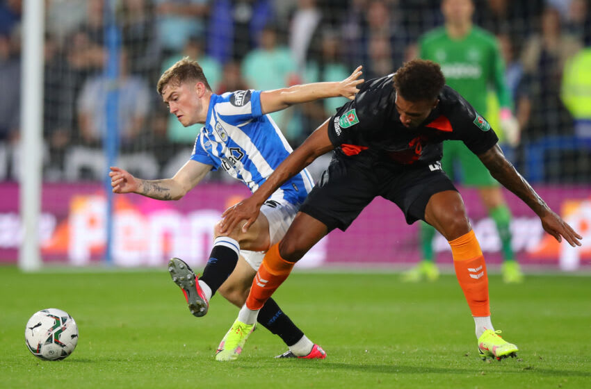 HUDDERSFIELD, ENGLAND - AUGUST 24: Scott High of Huddersfield Town and Jean-Philippe Gbamin of Everton during the Carabao Cup Second Round fixture between Huddersfield Town and Everton at The John Smiths Stadium on August 24, 2021 in Huddersfield, England. (Photo by Robbie Jay Barratt - AMA/Getty Images)