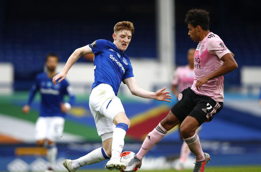 LIVERPOOL, ENGLAND - JULY 01: Anthony Gordon of Everton and James Justin of Leicester City battle for the ball during the Premier League match between Everton FC and Leicester City at Goodison Park on July 01, 2020 in Liverpool, England. Football Stadiums around Europe remain empty due to the Coronavirus Pandemic as Government social distancing laws prohibit fans inside venues resulting in all fixtures being played behind closed doors. (Photo by Clive Brunskill/Getty Images)