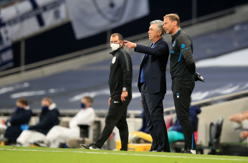 LONDON, ENGLAND - JULY 06: Carlo Ancelotti, Manager of Everton speaks with Duncan Ferguson assistant head coach during the Premier League match between Tottenham Hotspur and Everton FC at Tottenham Hotspur Stadium on July 06, 2020 in London, England. Football Stadiums around Europe remain empty due to the Coronavirus Pandemic as Government social distancing laws prohibit fans inside venues resulting in all fixtures being played behind closed doors. (Photo by Adam Davy/Pool via Getty Images)