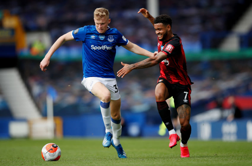 LIVERPOOL, ENGLAND - JULY 26: Jarrad Branthwaite of Everton and Joshua King of AFC Bournemouth compete for the ball during the Premier League match between Everton FC and AFC Bournemouth at Goodison Park on July 26, 2020 in Liverpool, England. Football Stadiums around Europe remain empty due to the Coronavirus Pandemic as Government social distancing laws prohibit fans inside venues resulting in all fixtures being played behind closed doors. (Photo by Clive Brunskill/Getty Images)