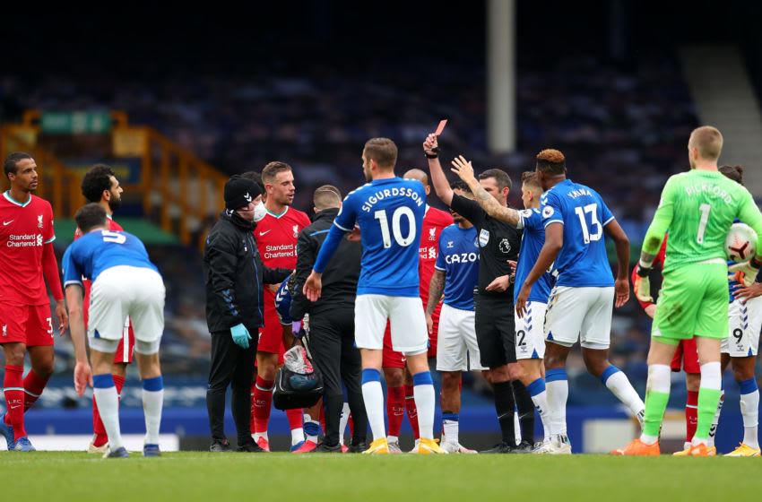 LIVERPOOL, ENGLAND - OCTOBER 17: Referee Michael Oliver shows a red card to Richarlison of Everton during the Premier League match between Everton and Liverpool at Goodison Park on October 17, 2020 in Liverpool, England. Sporting stadiums around the UK remain under strict restrictions due to the Coronavirus Pandemic as Government social distancing laws prohibit fans inside venues resulting in games being played behind closed doors. (Photo by Catherine Ivill/Getty Images)