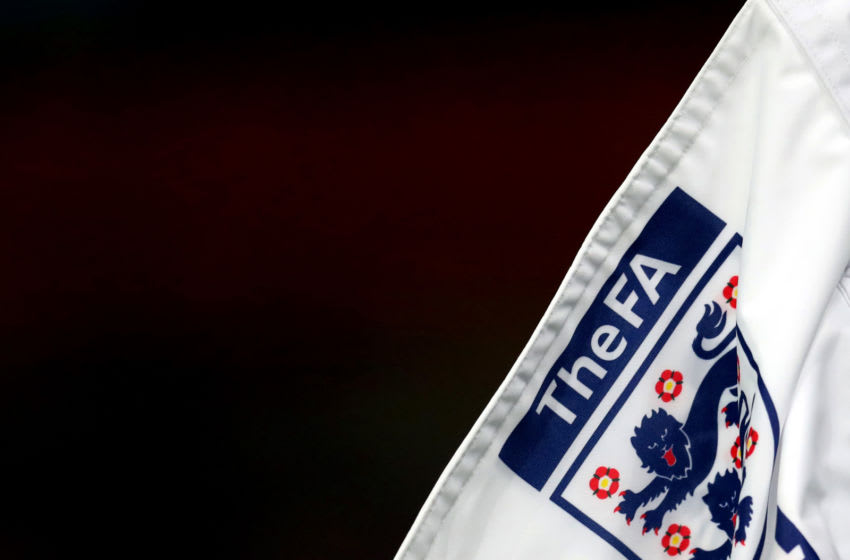 WOLVERHAMPTON, ENGLAND - NOVEMBER 13: Detailed view of The FA logo and England badge on the corner flag ahead of the UEFA Euro Under 21 Qualifier match between England U21 and Andorra U21 at Molineux on November 13, 2020 in Wolverhampton, England. Sporting stadiums around the UK remain under strict restrictions due to the Coronavirus Pandemic as Government social distancing laws prohibit fans inside venues resulting in games being played behind closed doors. (Photo by Catherine Ivill/Getty Images)