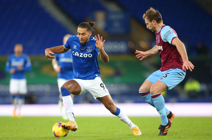LIVERPOOL, ENGLAND - JANUARY 01: Dominic Calvert-Lewin of Everton holds off a challenge from Craig Dawson of West Ham United during the Premier League match between Everton and West Ham United at Goodison Park on January 01, 2021 in Liverpool, England. The match will be played without fans, behind closed doors as a Covid-19 precaution. (Photo by James Gill - Danehouse/Getty Images)